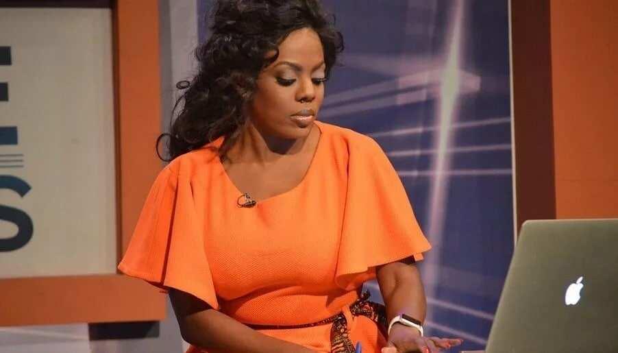 A woman wearing an orange dress