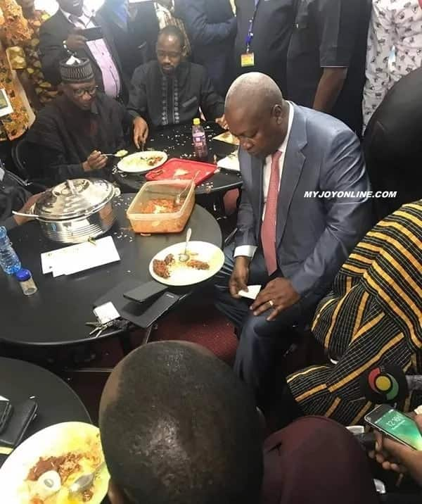 Mahama enjoying a plate of rice with NDC MPs after Akufo-Addo's SONA 'Last Supper' with NDC MPs