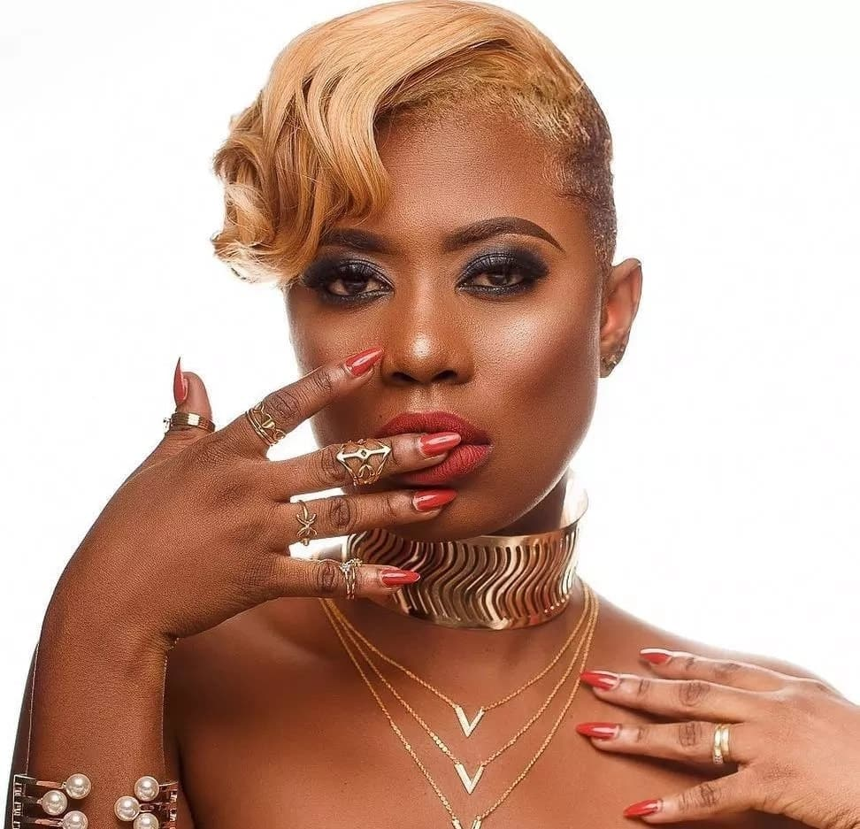 Ghanaian actress with blonde hair and gold jewelry
