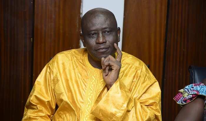 A man wearing a yellow dress