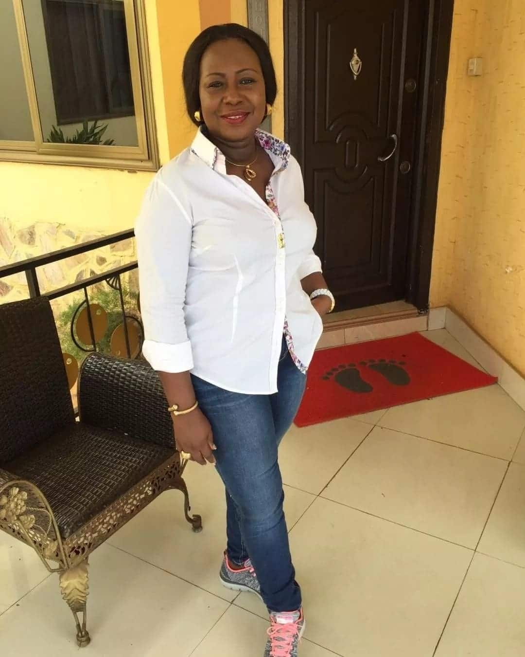 Gifty Anti wearing a white shirt and jeans