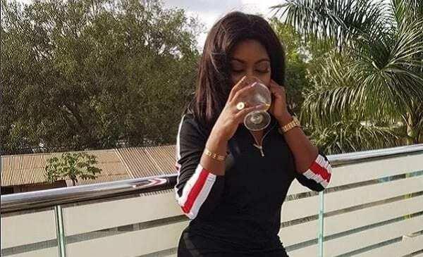 Afia Schwar drinking wine