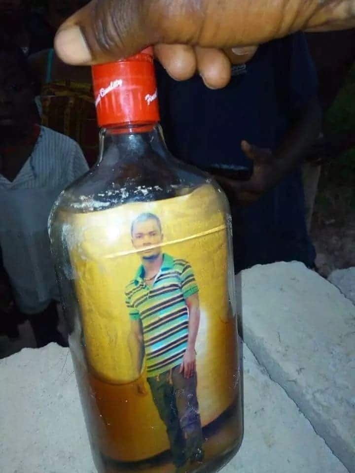This bottle with crucifix and picture was found floating on the Bonsa river at Tarkwa