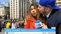 Fan grabs breast of DW reporter while she was reporting live at the World Cup