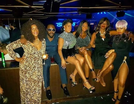 We are completely obsessed with these photos of Jim Iyke chilling with his sisters in Las Vegas