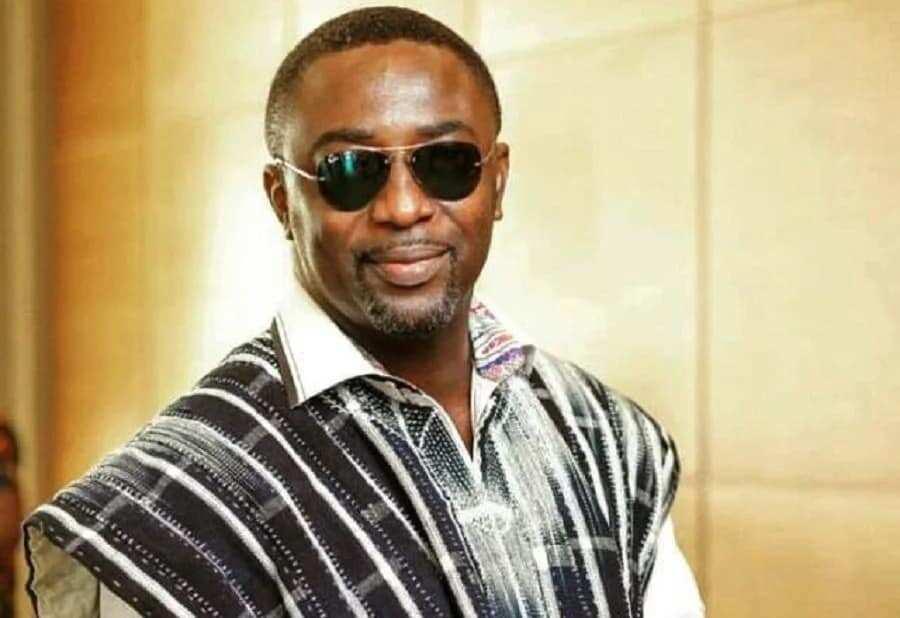 Ekow Smith-Asante in sunglasses and Batakari