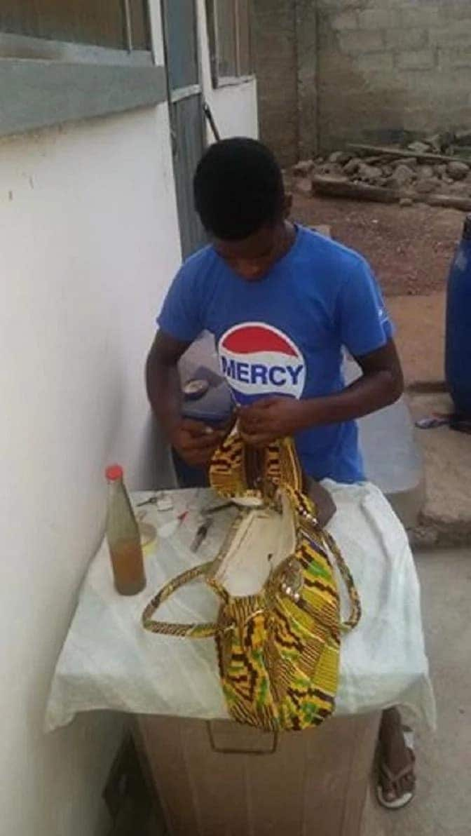 Kobby, working on a bag