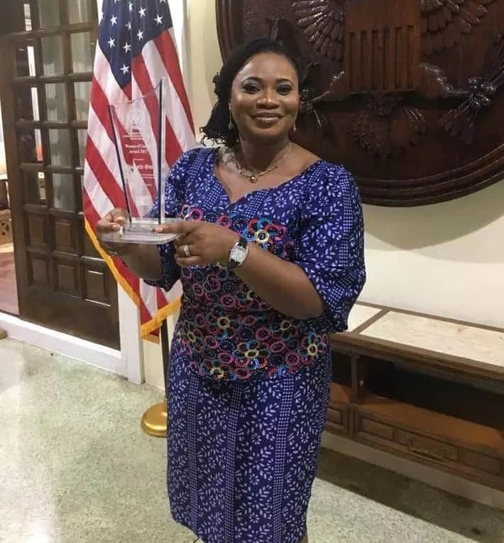 "Charlotte Osei with her ""Women of Courage"" award"