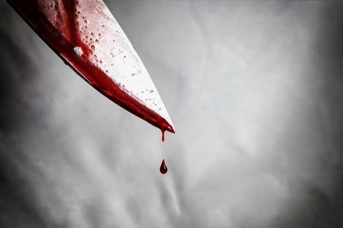 A knife dripping with blood