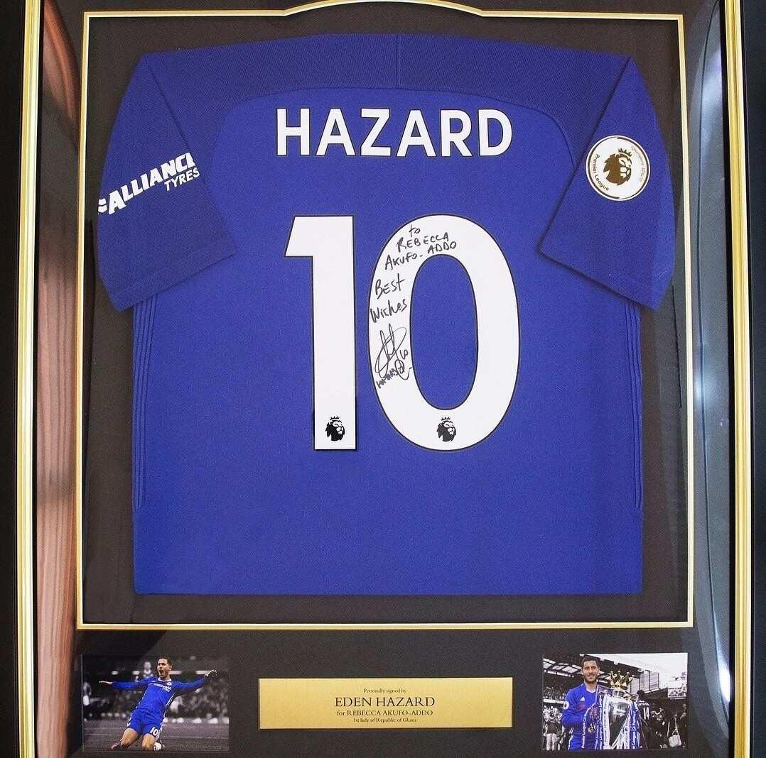 Rebecca Akufo-Addo receives signed Chelsea replica jersey from Eden Hazard