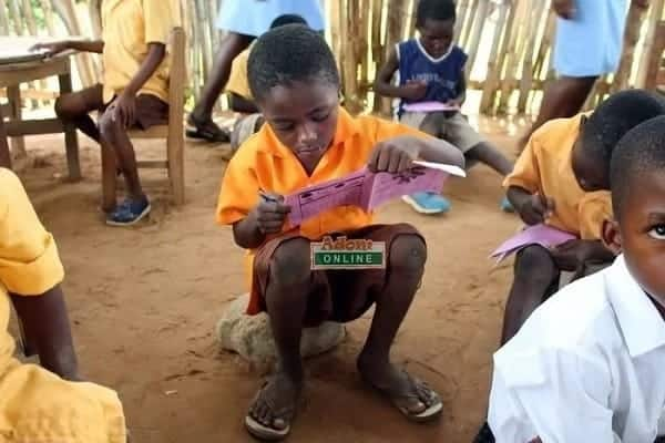 Tapa Amanya school children sit on stones for lessons in Volta Region