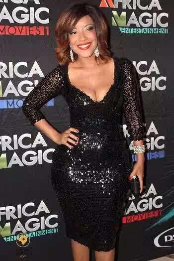 Joselyn Dumas poses for cameras wearing glittery black dress