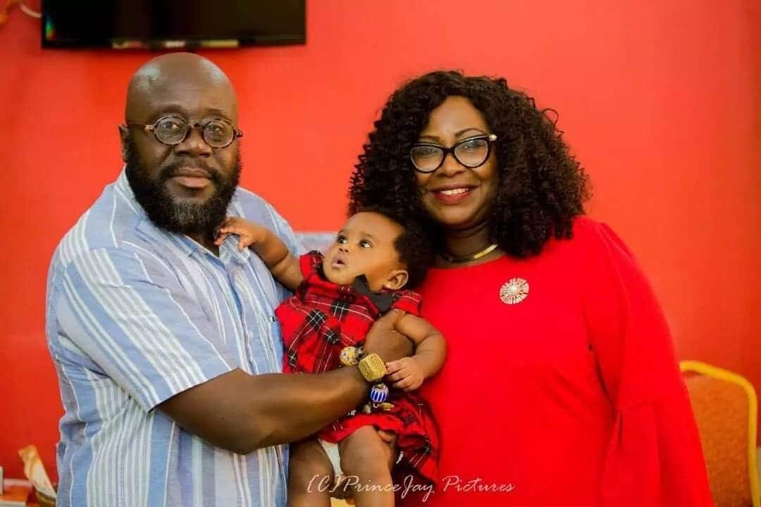 Gifty Anti with a man holding her baby