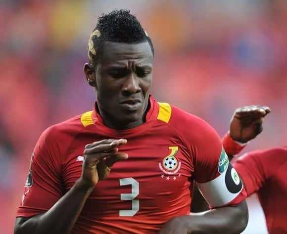 Asamoah Gyan makes a dance move with his hand