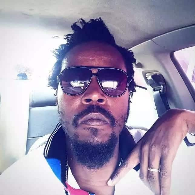 Kwaw Kese seated in a car