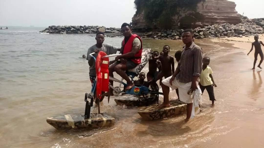 Man with bicycle invention at the beach