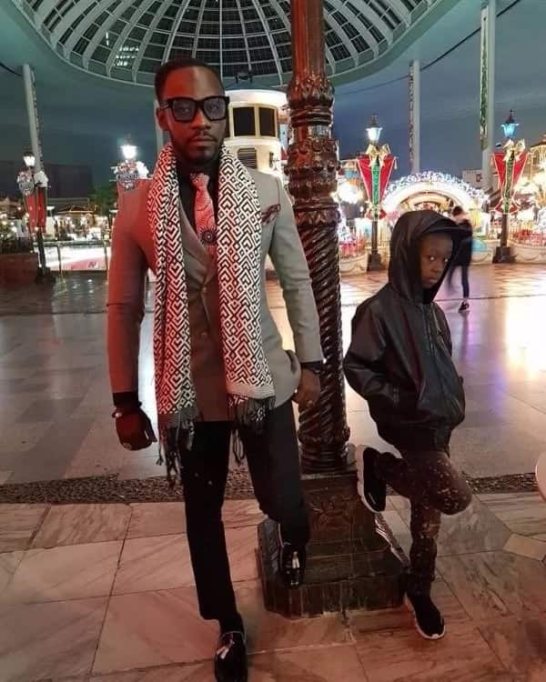 Okyeame Kwame and son battle for supremacy in new photo