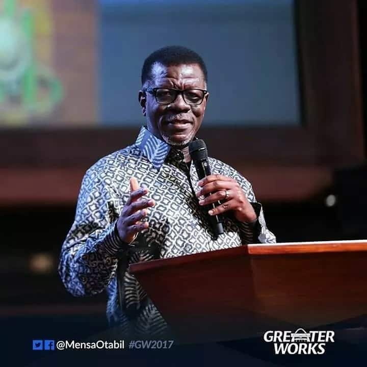 Dr. Otabil holding a microphone