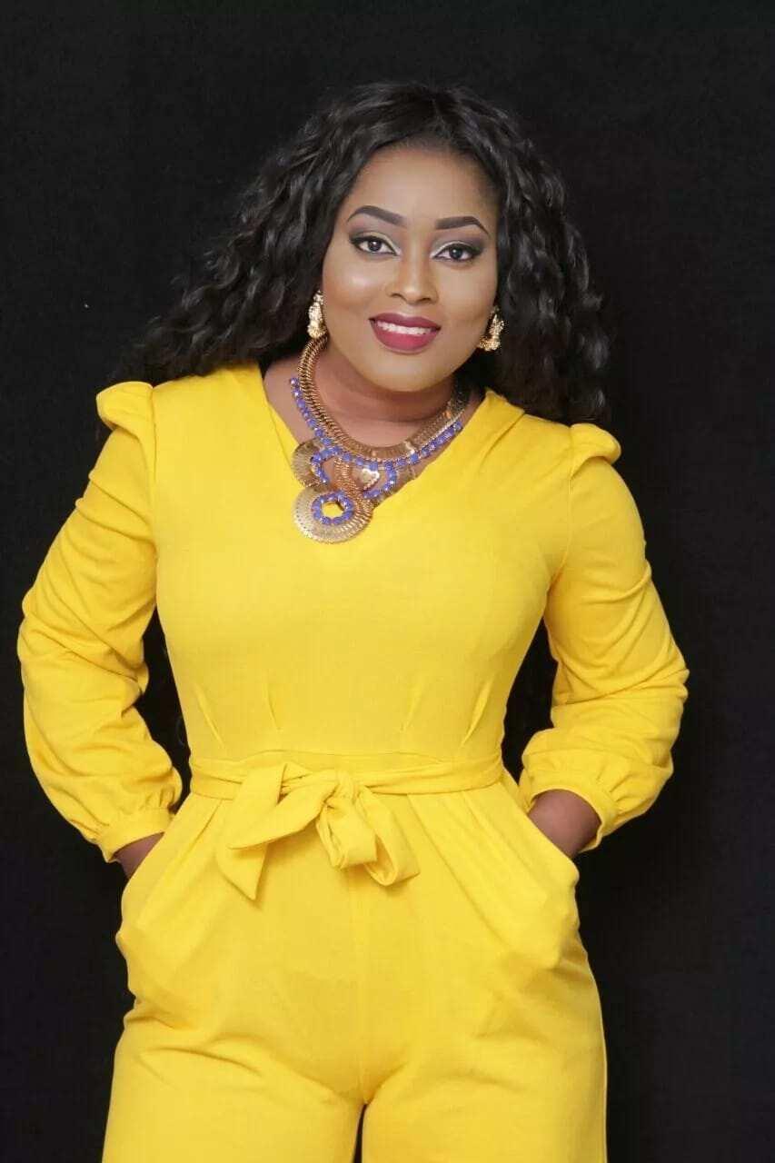 A woman wearing a yellow dress