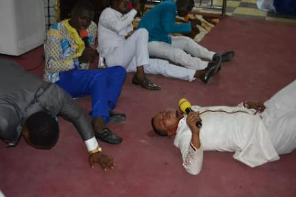 Obinim celebrates church member by rolling on the floor after he won ¢3billion 'lotto'