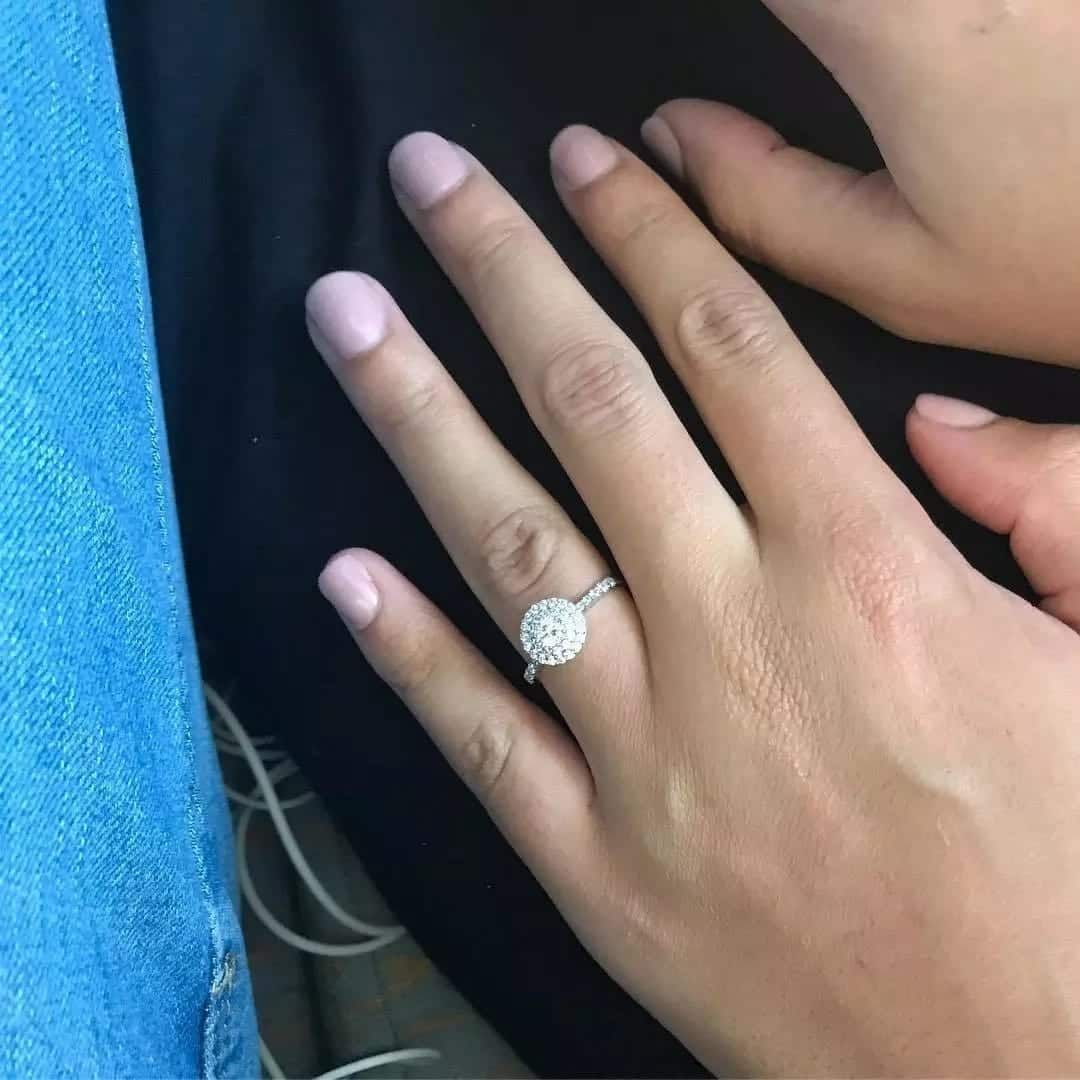 engagement ring on a finger