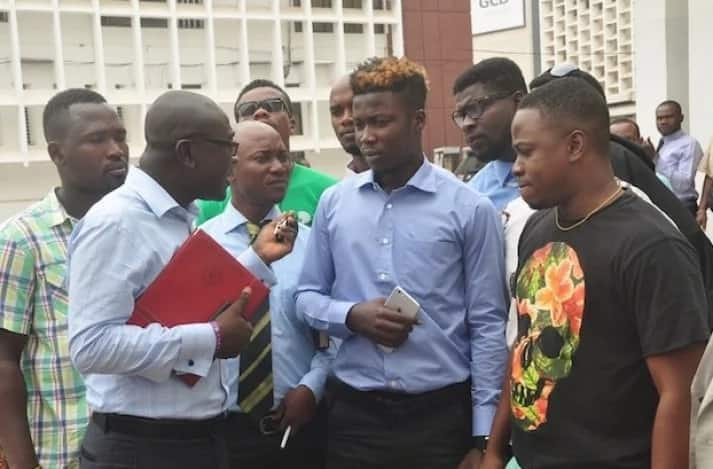 Wisa Greid stands with his legal counsel and friends