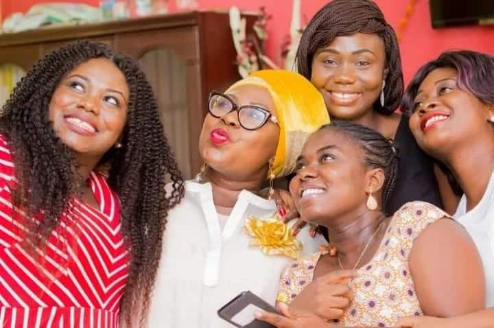 Gifty Anti takes a selfie with friends