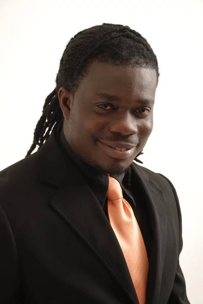 MUSIGA president in a black suit and pink tie