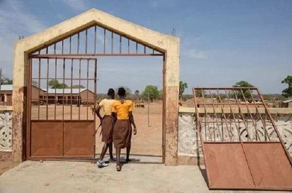 School girls entering a school compound