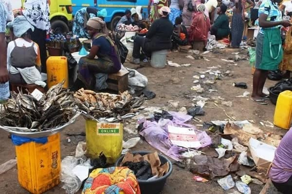 Traders surrounded by filth