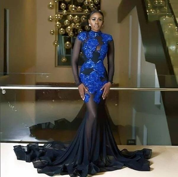 Nana Akua Addo wearing a blue and black dress