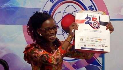 Police officer protects quiz mistress' handbag at NSMQ contest