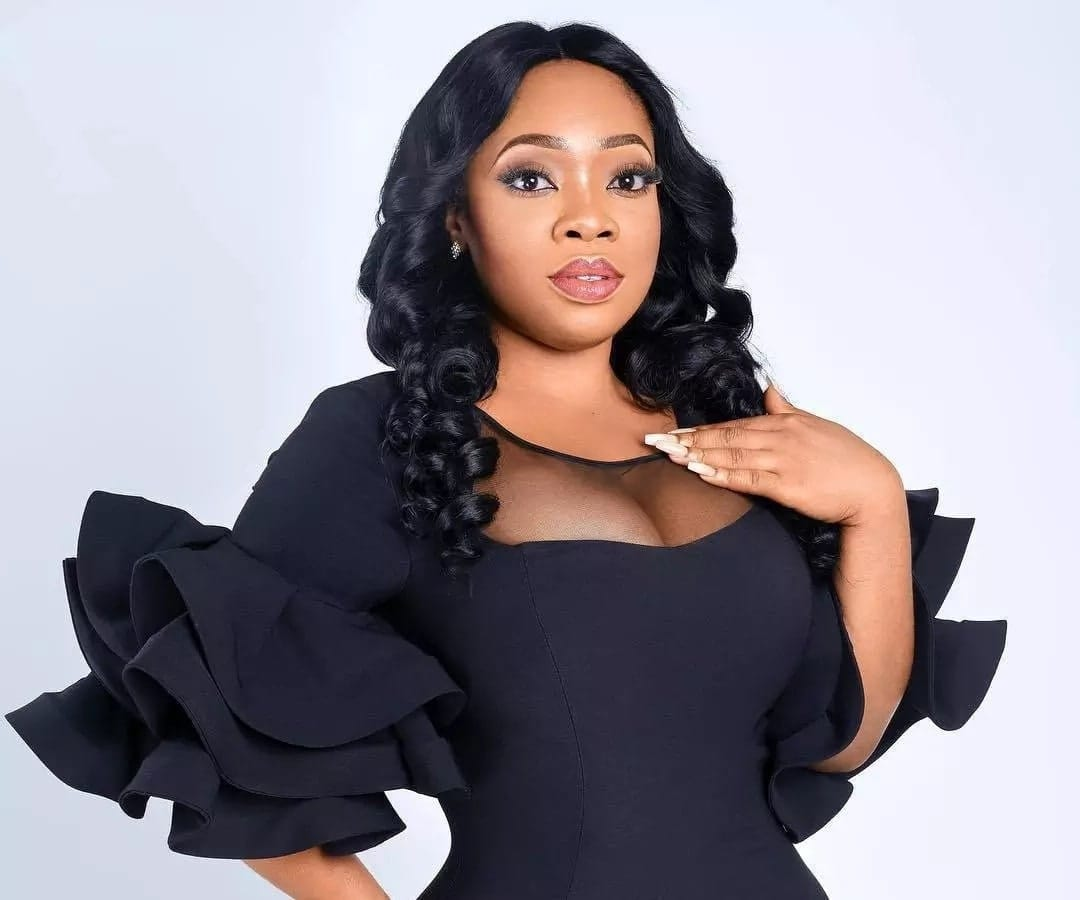 Moesha Boduong in black dress