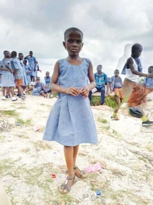 A young girl wearing a school uniform