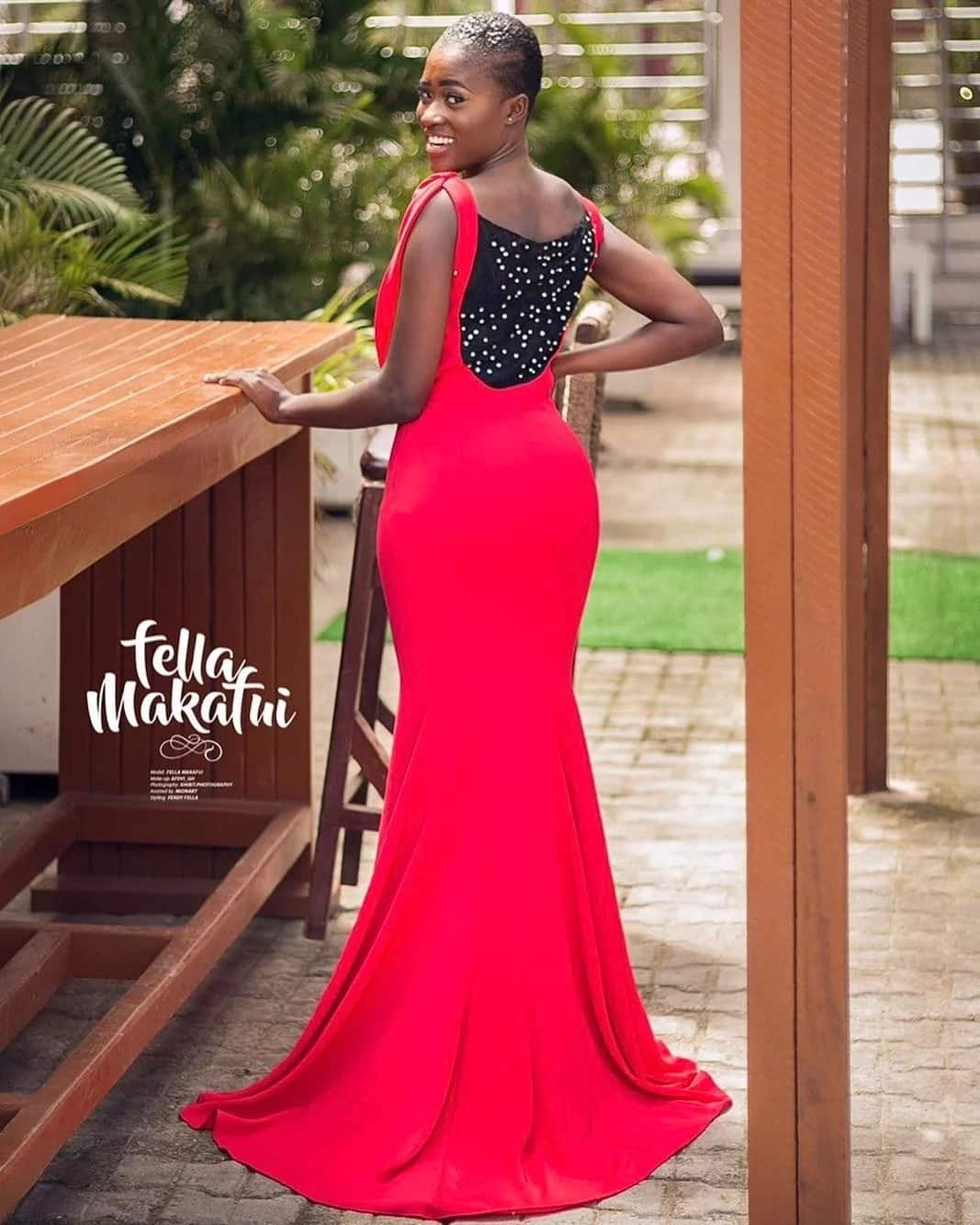Fella Makafui wearing a red and black dress