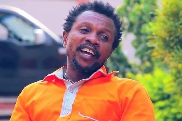 Kaakyire Kwame Appiah wearing an orange-cloured shirt