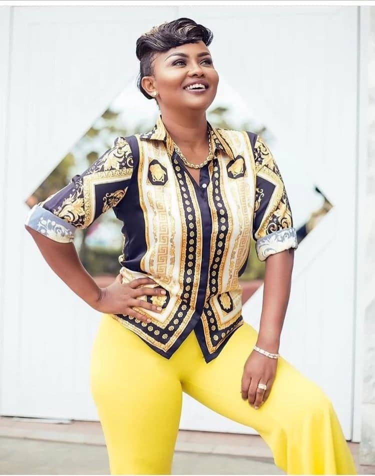 Nana Ama Mcbrown in stylish yellow outfit with wide smile