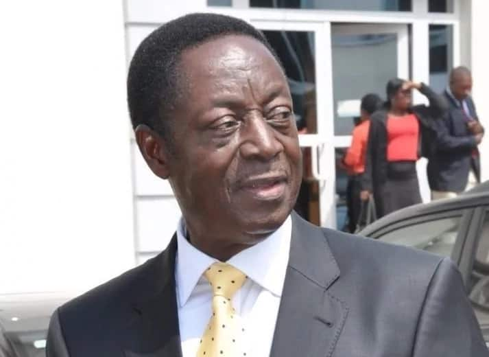 Dr. Kwabena Duffuor looking behind him