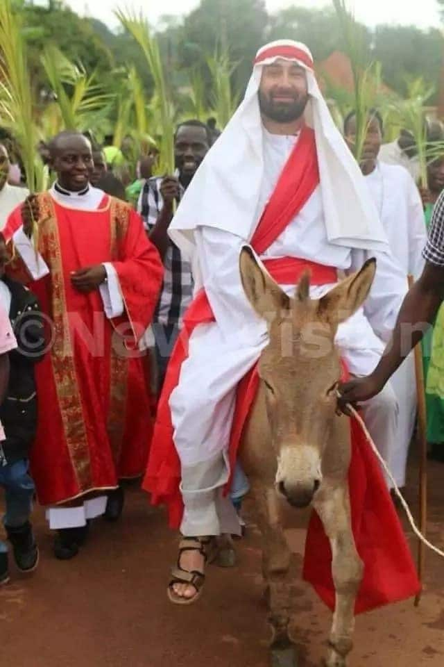 White Jesus leads dozens of African Christians on Palm Sunday