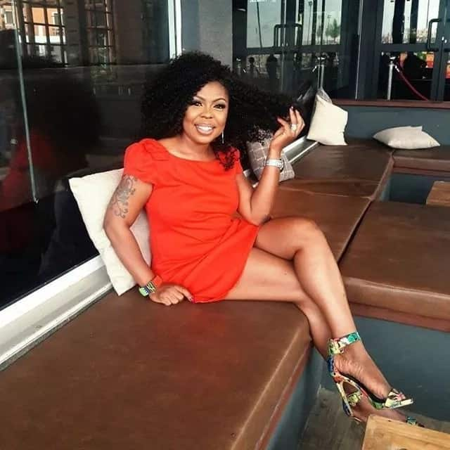 Afia Schwar wearing a red dress