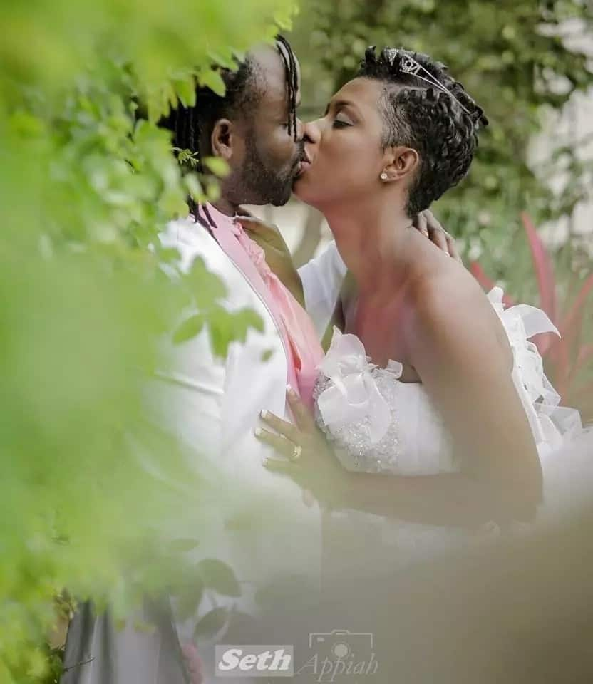 Ghanaian bride and groom embrace each other