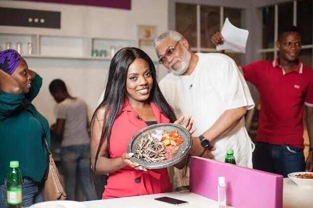 Nana Aba Anamoah holds up an Asanka to the cameras