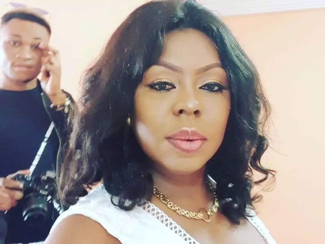Afia Schwarzenegger takes a photo with a man holding a camera behind her