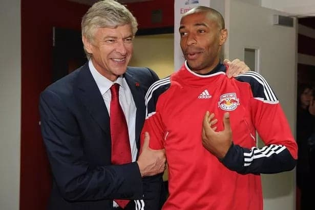 Henry with Wenger during a preseason friendly