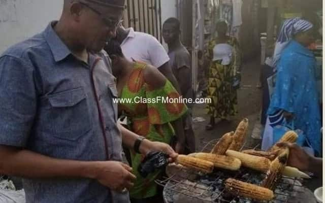 Hamid buys roadside corn at Nima