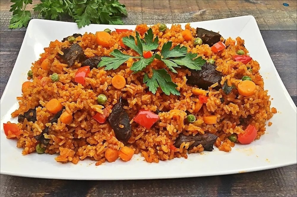 Jollof rice served with meat and peppers