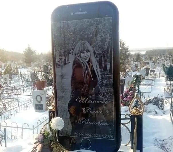 Phone addict buried under a tombstone shaped like her favourite iPhone