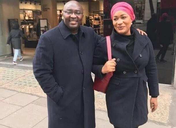 Dr. Mahamudu Bawumia and Samira Bawumia wearing black coats