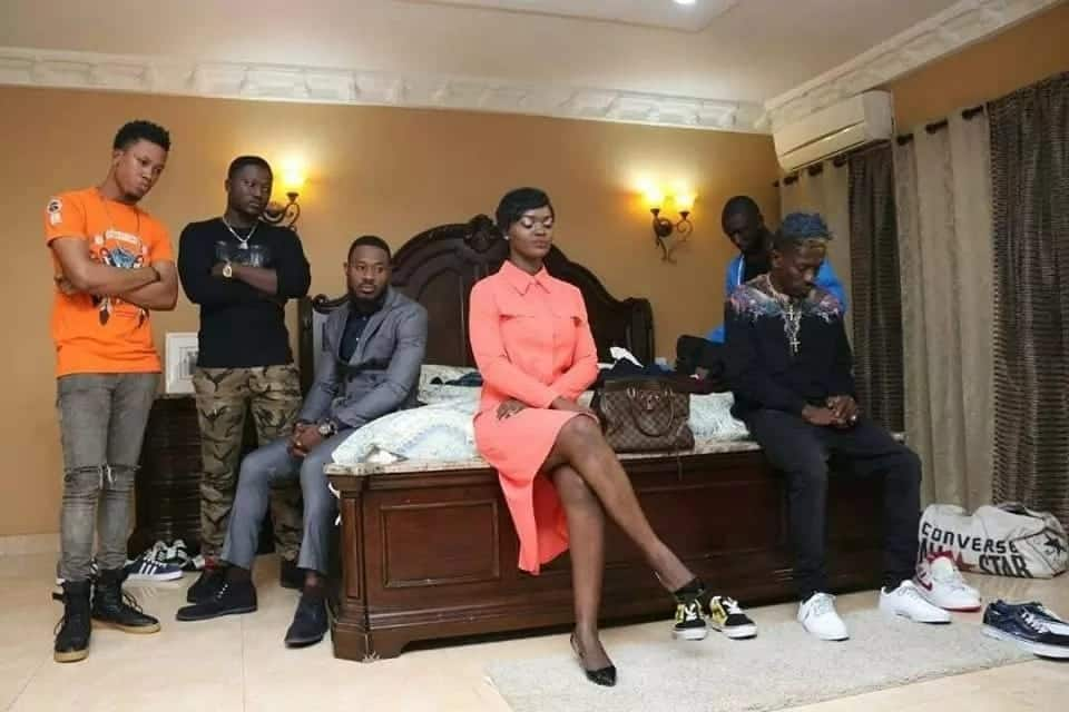Shatta Wale in a room with other people