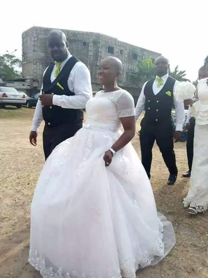 A Nigerian couple lead the procession at their white wedding